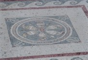 An intricately tiled floor on Delos