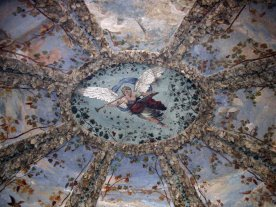 "Looking up at the ""oozing"" stone and artwork in the ceiling of the Pitti Palace grotto."