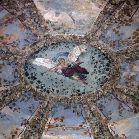 """Looking up at the """"oozing"""" stone and artwork in the ceiling of the Pitti Palace grotto."""