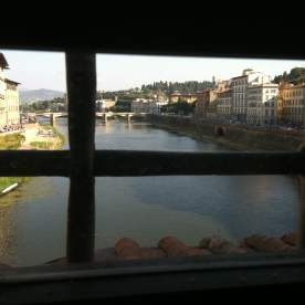 Looking down the River Arno from inside the Vasari Corridor.