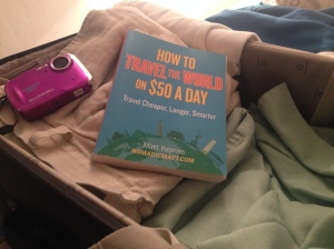 Shorts, shirts, underwater camera and a book to teach us how to do it for less.