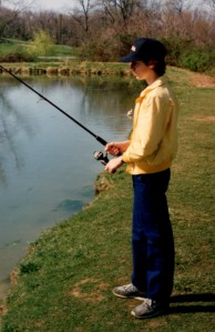 Young Zeke casts a line in Brownsville Pond.