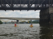 Zeke and Andi paddle under the railroad bridge.