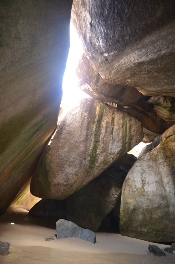 Sunlight filters in through the boulders that make up The Baths.