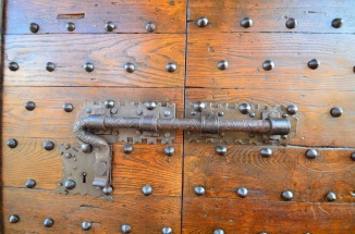 One of the iron locks on the jewelry store windows.