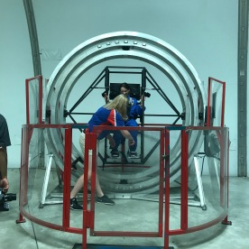 Getting strapped into the Multi-Axis Trainer